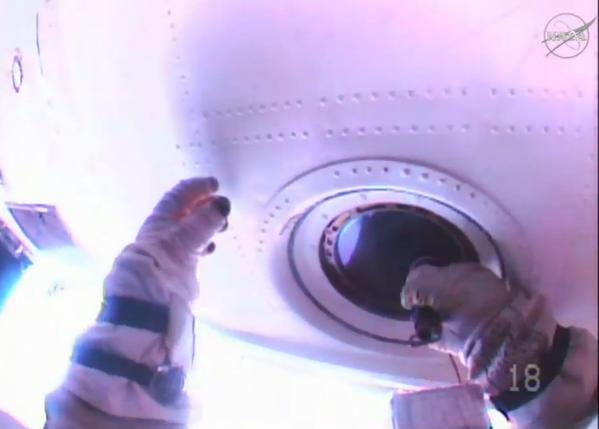 astronaut cleaning window